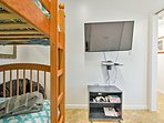 This room contains a twin-over-twin bunk bed and flat-screen TV.