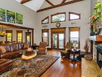 Spacious living area with gas fireplace, hardwood floors and filled with natural light.