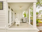 Outdoor porch features a grill with propane.