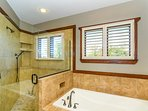 Soaker tub and large walk-in shower in master bath.