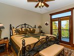 Second master bedroom has king bed, en suite bath and balcony with mountain views.