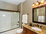 Second master bedroom's en suite bath has tub/shower combination.