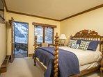 4th bedroom with queen bed, TV, en-suite bath.