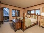 3rd bedroom with queen bed, TV, en-suite bath.