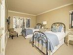 5th bedroom with two twin beds, TV, en-suite bath.
