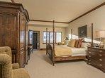 Jr. master suite with king bed, TV, en-suite bath.