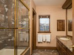Master en-suite bath with shower-tub combo.