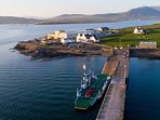 Take the ferry from Renard Point near Cahirciveen Town to Valentia Island.