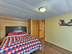 Relax on the comfortable queen mattress in the second bedroom.