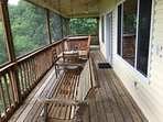 Large deck with porch swing and rocking chairs to enjoy the view