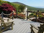 The decking outside the dining room is the perfect spot for a cup of tea and admiring the view