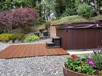 New 6 person hot tub with cover on, steps and decking in lovely landscaped garden