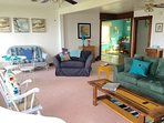 Ceiling fans in most rooms, decorated in shades of the sea - teal, blue, coral, beige, white...