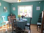 Sunny eat in diningroom with a bow window!