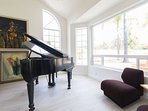 Formal living room. We use it for our baby grand piano.
