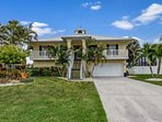 The quintessential Old Florida, Key West style home, located on the shores of the Imperial River is ready to welcome...