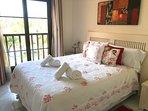 Kingsize bed in master bedroom with ensuite bathroom