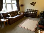 Cottage of Aird - cosy lounge with wood burning stove