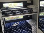 Twin bunks in 2nd bedroom also has a Love seat.