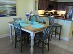 Enjoy meals from the Kitchen while taking in views of the Gulf (Seating for 6)