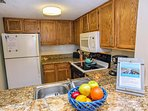 Sparkling, well stocked, granite kitchen with ice maker, dishwasher and microwave.
