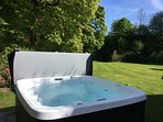 Hot tub in beautiful lawned area by the river
