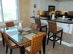 Enjoy meals from the Kitchen while taking in endless views (Seating for 6)