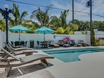 Relax poolside.  Plenty of lounge chairs and umbrella's for a fun day at LuLu's pool.