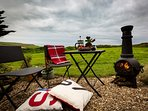 Cuddle up in a blanket whilst watching the sun go down with spectacular sea views