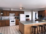 Spacious kitchen with extra sittings at the island right next to the dinning table.