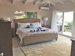 Your newly redecorated master bedroom is beautiful and opens on to the pool deck! (2018 photo)
