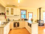 The large open plan kitchen has everything you need to cook up a storm