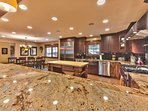 Gourmet Kitchen with SubZero Refrigerator, Wolf Stove, Granite Counters, Bar Seating for 5