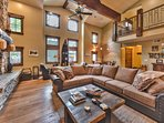 Great Room Living Area with Large Stone Fireplace, Vaulted Ceilings, Large Flat Screen TV, DVD