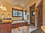 Grand Master Private Bath with Jetted Tub, Walk In Stone Shower, Dual Vanities