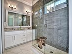 Master bathroom has large walk in shower and double sinks.