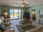 Spacious living space, Large flat screen TV, comfortable seating and amazing ocean view.