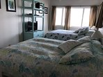Guest bedroom equipped with 2 Queen beds and ocean views