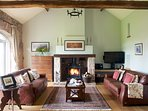The welcoming Carriage reception room is equipped with broadband wifi, leather sofas and a log fire