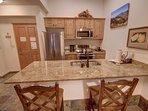 Fully equipped kitchen with bar stool seating