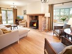 Living Room with cast iron log stove - complimentary logs provided for guests. Doors open to terrace