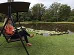 Relax on the outdoor swing in beautiful surrounds.