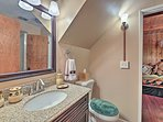 The Jack-and-Jill bathroom offers a walk-in shower.