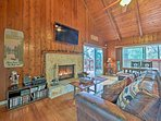 Pine-paneled vaulted ceilings perfectly frame the spacious living room.