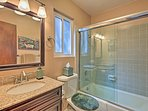 Sliding glass doors complete the shower/tub combo.