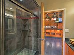 This Jack-and-Jill style bathroom can be found just off the kitchen.