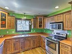 With stainless steel appliances and expansive countertops, the kitchen is 5-star.