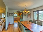 The dining table sits just steps from the kitchen.