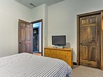 All of the bedrooms feature flat-screen cable TVs.