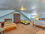 The upstairs bedroom boasts 1 full bed and 2 twin beds.